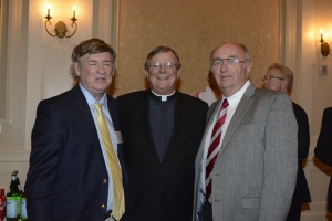 OC, pictured with Fairfield president Jeffrey von Arx, SJ, and Dick Hoops Weiss, stays forever young.