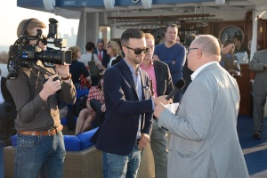 Norwegian media traveled to U.S. with Papagayo E. contingent, interviewed Anderson chatting it up on dinner cruise.