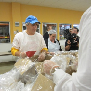 Galterio rolls up sleeves to help less fortunate, here at the Food Bank of Westchester