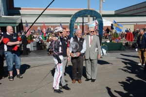 Raceway president Tim Rooney and NY SOA president Joe Faraldo present the Yonkers International trophy to the winning connections